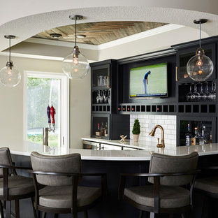 Home bar - large country home bar idea in Minneapolis with white countertops