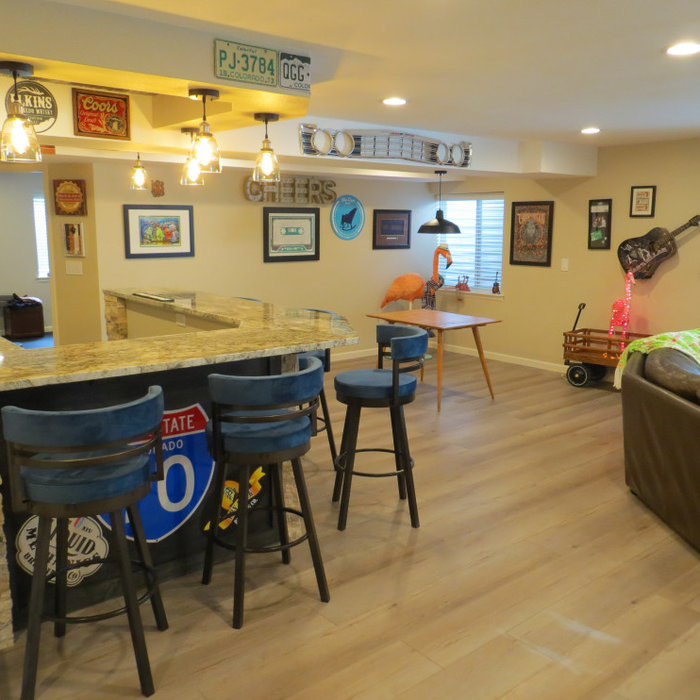 The client had a ton of very interesting art and memorabilia from trips they had taken and built a home bar to enjoy it with their friends.  We recycled cabinets that we faux painted. Stone accents we