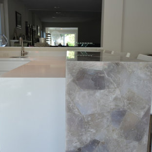 Inspiration for a large shabby-chic style l-shaped ceramic floor and beige floor seated home bar remodel in Los Angeles with an undermount sink and white cabinets