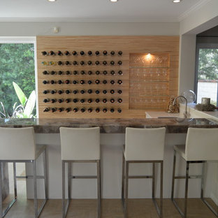 Large cottage chic l-shaped ceramic floor and beige floor seated home bar photo in Los Angeles with an undermount sink and white cabinets