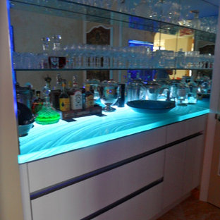 Photo of a large modern single-wall home bar in Miami with flat-panel cabinets, white cabinets and mirror splashback.