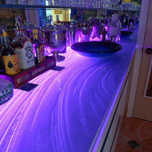 This is an example of a large modern single-wall home bar in Miami with flat-panel cabinets, white cabinets and mirror splashback.