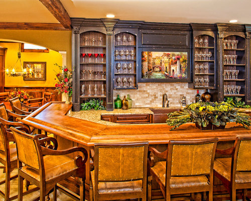 Traditional u-shaped carpeted home bar idea in Raleigh with raised-panel  cabinets,