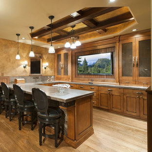 Inspiration for a large timeless u-shaped light wood floor and beige floor seated home bar remodel in Other with shaker cabinets, medium tone wood cabinets and gray countertops