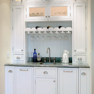 Example Of A Classic Home Bar Design In Other With Glass Front Cabinets