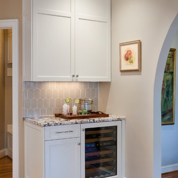 Traditional remodel with walnut island.