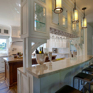 Inspiration for a large country u-shaped porcelain tile seated home bar remodel in Los Angeles with an undermount sink, recessed-panel cabinets, white cabinets, quartzite countertops, white backsplash and mosaic tile backsplash
