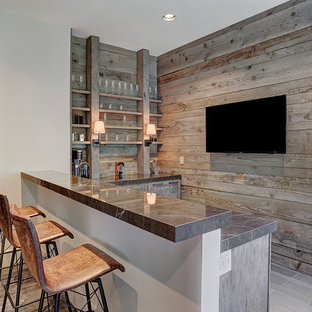 Wet bar - transitional l-shaped gray floor wet bar idea in Houston with shaker cabinets, distressed cabinets and wood backsplash