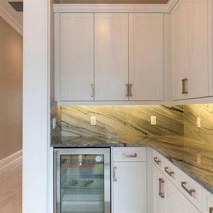 Design ideas for a small classic l-shaped wet bar in Orlando with shaker cabinets, white cabinets, granite worktops, grey splashback, stone slab splashback and grey worktops.