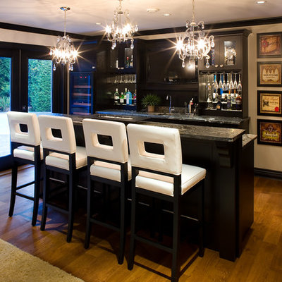 Inspiration for a transitional galley medium tone wood floor seated home bar remodel in Vancouver with black cabinets