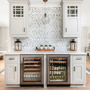 This is an example of a classic single-wall home bar in Atlanta with no sink, shaker cabinets, grey cabinets, multi-coloured splashback, medium hardwood flooring and white worktops.