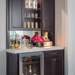 Inspiration for a medium sized traditional single-wall wet bar in San Francisco with dark wood cabinets, mirror splashback, dark hardwood flooring, marble worktops, multi-coloured splashback, brown floors and recessed-panel cabinets.