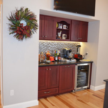 Transitional New Constrn. Home Bar w/ Red Stain cabinets & metallic backsplash