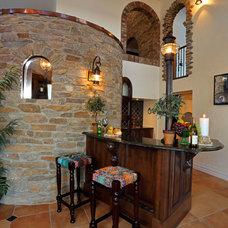Mediterranean Home Bar by Wolf Custom Homes Ltd.