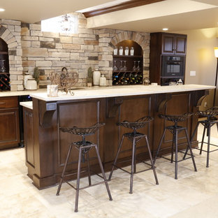 This is an example of a large rustic galley wet bar in Cleveland with beige floors, red cabinets and beige worktops.