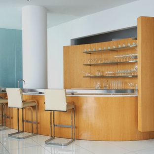 Modern u-shaped breakfast bar in Dallas with open cabinets, stainless steel worktops, orange splashback, wood splashback and white floors.