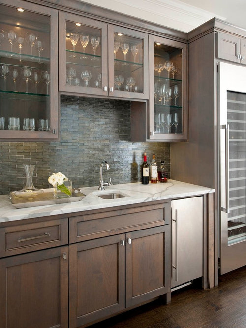 traditional single wall dark wood floor and brown floor wet bar idea in dallas with - Matchstick Tile Home Design