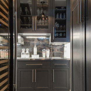 Inspiration for a medium sized traditional home bar in Denver with grey cabinets, brown splashback, stainless steel worktops, ceramic splashback, ceramic flooring, grey floors, grey worktops and shaker cabinets.