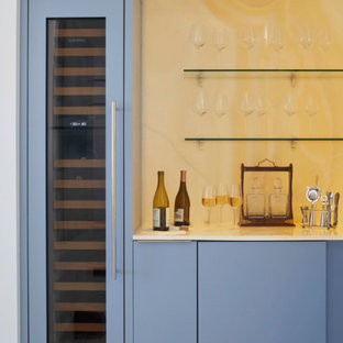 Home bar - mid-sized contemporary single-wall home bar idea in Miami with flat-panel cabinets, blue cabinets, marble countertops and marble backsplash