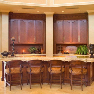 Large traditional galley breakfast bar in San Francisco with no sink, flat-panel cabinets, brown cabinets, marble worktops, porcelain flooring, beige floors and beige worktops.