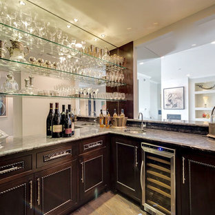 Design ideas for a large contemporary l-shaped wet bar in Dallas with a submerged sink, dark wood cabinets, light hardwood flooring, beaded cabinets, marble worktops, brown splashback, mirror splashback, brown floors and brown worktops.