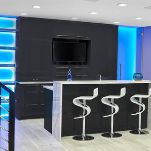 Design ideas for a large contemporary galley wet bar in Edmonton with a submerged sink, glass-front cabinets, white cabinets, engineered stone countertops, porcelain flooring, grey floors and white worktops.
