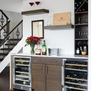 Contemporary single-wall home bar in DC Metro with dark wood cabinets, dark hardwood flooring and brown floors.