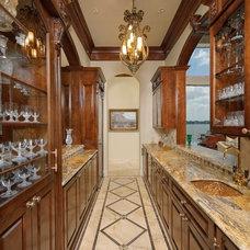 Mediterranean Home Bar by Gary Keith Jackson Design Inc