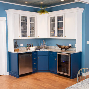 Photo of a medium sized beach style u-shaped wet bar in Chicago with a submerged sink, shaker cabinets, white cabinets, medium hardwood flooring and brown floors.