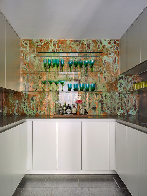 Example Of A Trendy U Shaped Gray Floor Home Bar Design In New York With
