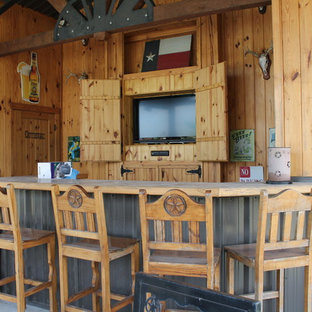 Example of a large mountain style home bar design in Austin