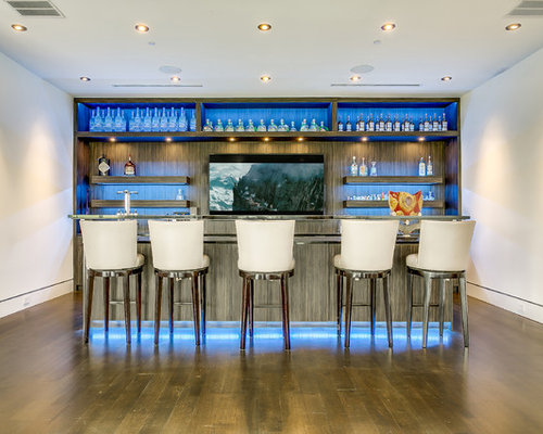 This Is An Example Of A Modern Wet Bar In Dallas With Glass Front Cabinets