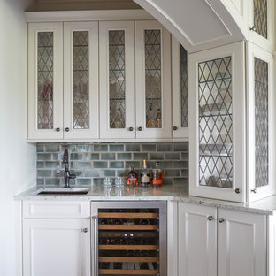 Wet Bar with Arched Opening and Glass Fronted Cabinetry