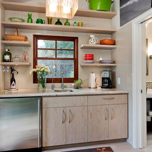 Mid-sized trendy single-wall porcelain floor and beige floor wet bar photo in San Francisco with light wood cabinets, white countertops, flat-panel cabinets, an undermount sink, quartzite countertops, beige backsplash and porcelain backsplash