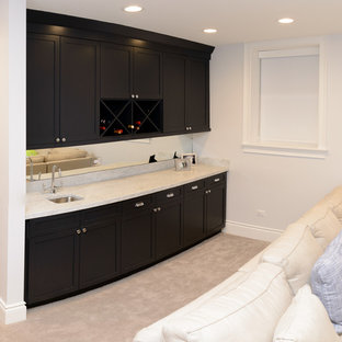 This is an example of a small contemporary u-shaped wet bar in Chicago with marble worktops, a submerged sink, shaker cabinets, dark wood cabinets, mirror splashback and carpet.