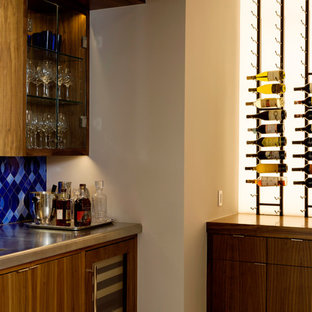 Example of a mid-sized trendy l-shaped porcelain floor wet bar design in Houston with flat-panel cabinets, medium tone wood cabinets, stainless steel countertops, blue backsplash and porcelain backsplash