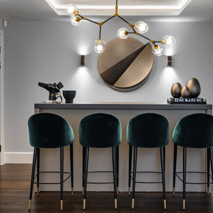 This is an example of a contemporary home bar in London.