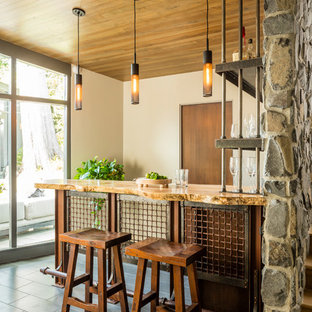 This is an example of a rustic breakfast bar in Seattle with open cabinets, wood worktops and grey floors.