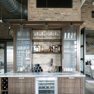 Inspiration for a mid-sized industrial single-wall dark wood floor home bar remodel in Denver with an undermount sink, quartz countertops, brick backsplash and dark wood cabinets