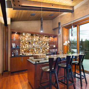 Photo of a contemporary galley wet bar in Denver with flat-panel cabinets, medium wood cabinets, medium hardwood flooring and brown floors.