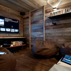 Rustic Home Theater by Inspired Dwellings