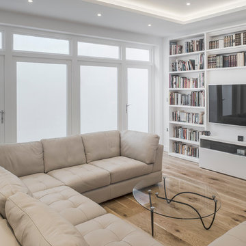 Basement Family/Games/TV room, flooded with light from double aspect lightwells.