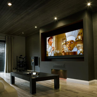 Design ideas for a modern home cinema in West Midlands.
