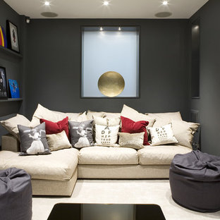 Photo of a small contemporary enclosed home cinema in London with grey walls, carpet and a projector screen.