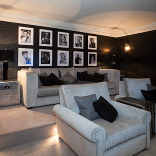 This is an example of a classic enclosed home cinema in Berkshire with carpet and grey floors.