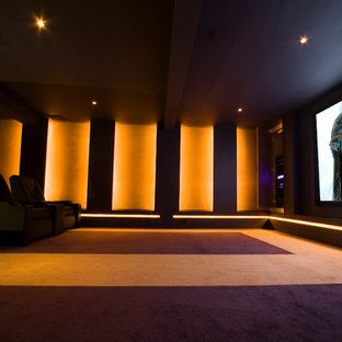Design ideas for a large modern enclosed home cinema in Other with purple walls, carpet and a projector screen.