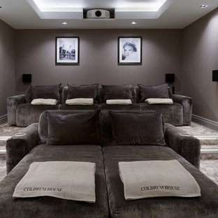 Design ideas for a large modern enclosed home cinema in London with carpet, a projector screen and grey walls.