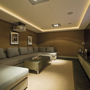 Design ideas for a contemporary home cinema in London with brown walls.