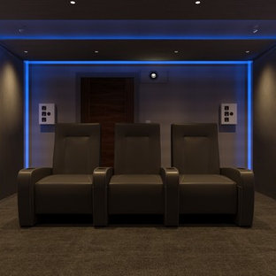 Medium sized contemporary home cinema in Sussex.
