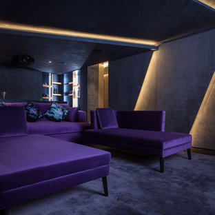 Photo of a medium sized contemporary enclosed home cinema in London with grey walls, carpet, grey floors and a projector screen.